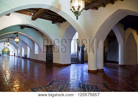 Santa Barbara, U.S.A. - June 1, 2011: The arcade with   classical decorations and lamps in the Court House inside.
