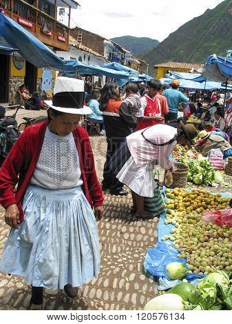 PISAC, PERU - MARCH 2, 2006: Unidentified people at the market in Pisac. It is a Peruvian village in the Sacred Valley. The village is well known for its market every Sunday Tuesday and Thursday.