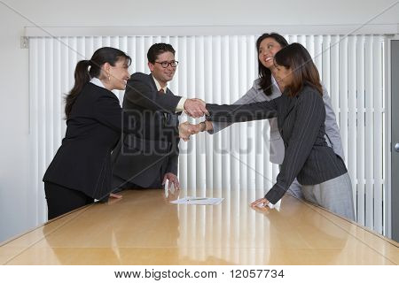 Business professionals shake hands on a deal