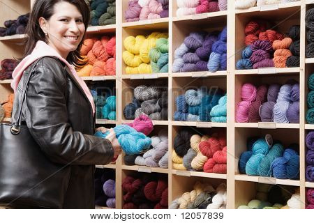 Female customer in yarn shop