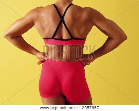 Female body builder flexing