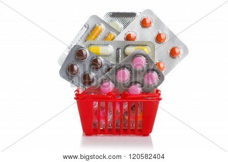 Shopping trolley with pills and medicine isolated on white