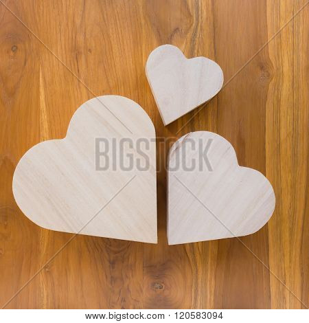 Wood Heart Arrange Shaped Cloud On Brown Wooden Background