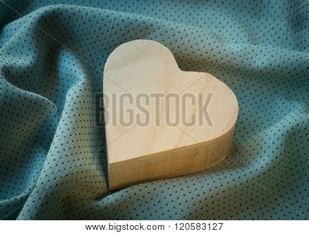 Heart  Wooden Box On Cloth Fabric Background