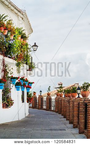 Blue Pots of Mijas in an alleyway, Andalucia, near Malaga, Spain