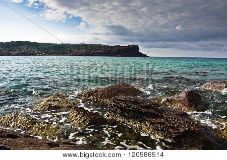 Sea rocks and waves at beach in San Pietro island, Sardinia