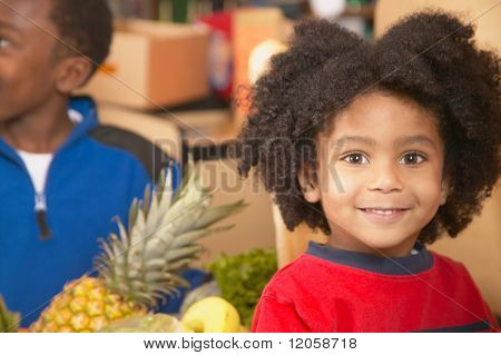 Young African American boy in supermarket