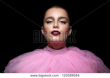 Beautiful girl in pink lace collar