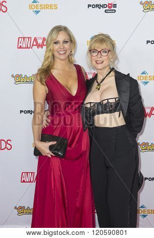 LAS VEGAS - JAN 23 : Adult film actress Julia Ann (L) and adult film actress/director Nina Hartley attend the 2016 Adult Video News Awards at the Hard Rock Hotel & Casino on January 23 2016 in Las Vegas Nevada.