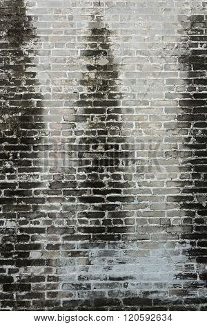 Dirty Old Brick Wall With Black Stain On Wall Background
