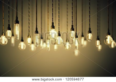 Bulbs With Long Filaments On Brown Background