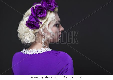 Fashion And Beauty Concepts. Portrait Of Blond Caucasian Female With Purple Flowery Crown Posing Aga