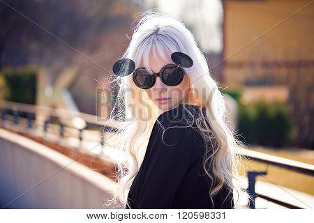 Beautiful Blonde Girl In Sunglassses Outdoors