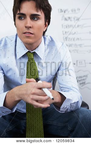 Young businessman looking pensive
