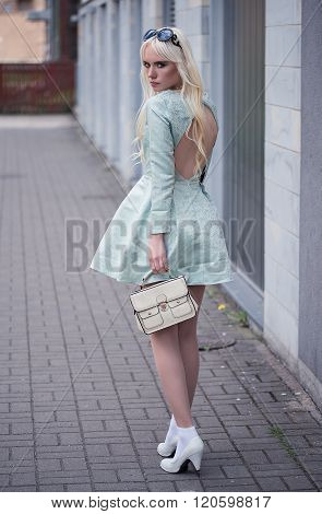 Lovely Blonde Young Woman In Posing Outdoors