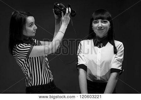Puzzled photographer and brunette model