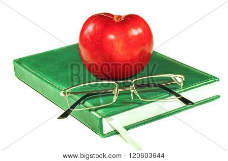 Apple And Glasses On A Book
