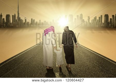 Arabic Family Walking On The Highway