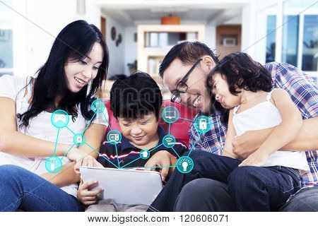 Family Using Tablet With Smart Home System