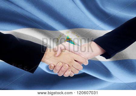 Partnership Handshake With Flag Of Nicaragua