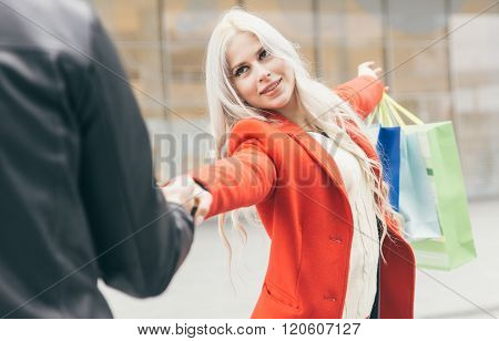Beautiful Woman Inviting Her Man To Make Shopping In The City Center