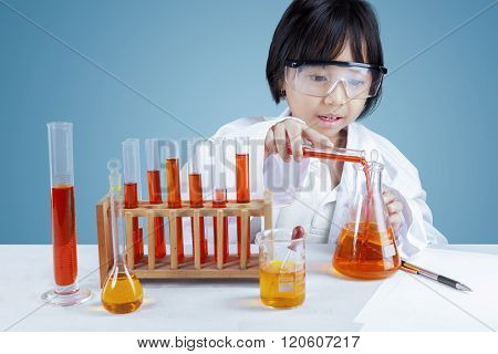 Scientist Mixing The Chemical Fluid