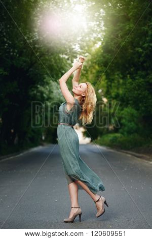 Young Woman Dancing On The Road