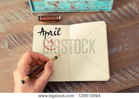 April 5 Calendar Day Handwritten On Notebook
