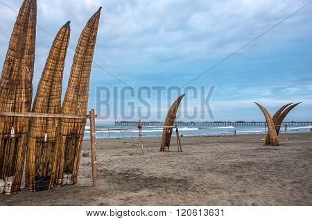 Traditional Peruvian Small Reed Boats (caballitos De Totora), Straw Boats Still Used By Local Fisher