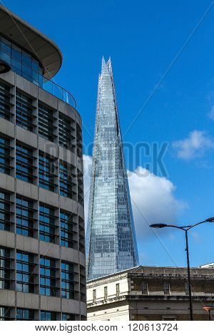LONDON UK - JUNE 6 2015: The Shard towering over London on blue sky background tallest building in Europe at over 1000 feet (310 metres).