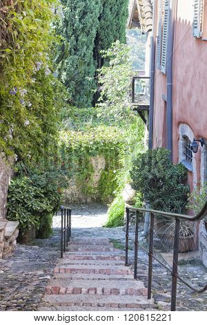 Walkway in narrow alleyway  in old French town