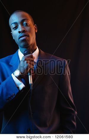 Businessman speaking into a microphone
