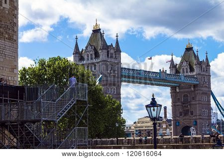 London,UK - June 6, 2015: Unidentified tourists on Tower Bridge and blue sky background