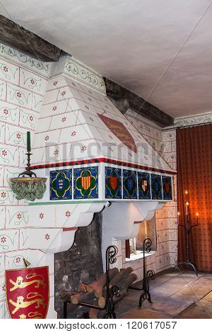 LONDON UK - JUNE 6 2015: Fireplace in recreation of Edward I's bedchamber in St Thomas's Tower. Tower of London