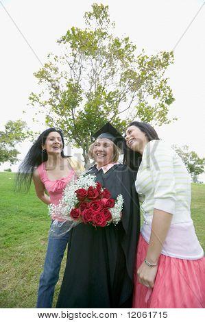 Graduate mother receiving praise