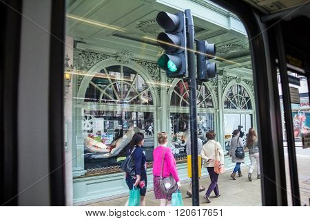 LONDON UK - JUNE 6 2015: Unidentified people in Piccadilly street . View from bus windiw. The city is visited by more than 30 million people every year.