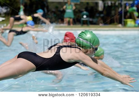 Girl in swimming gala race