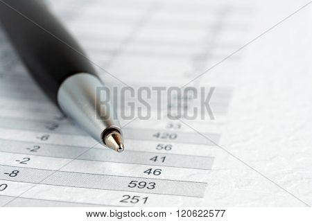 Black Ballpoint Pen On A Sheet