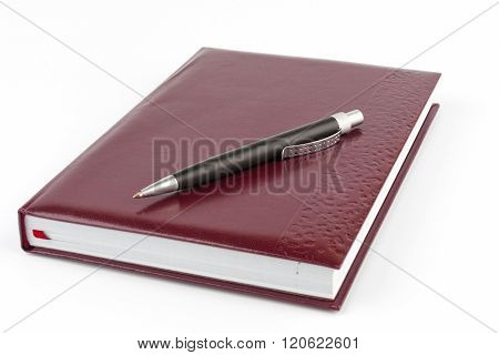 Black Ballpoint Pen Lying On The Leather Cover Book