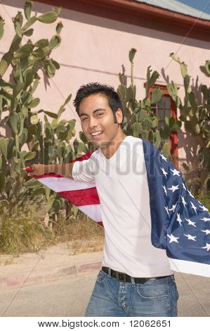 Young man draped in an American flag