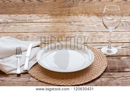 Fine empty tableware on wooden background