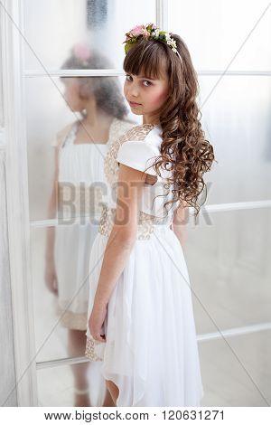 Tender Brunette Girl Standing Near The Door
