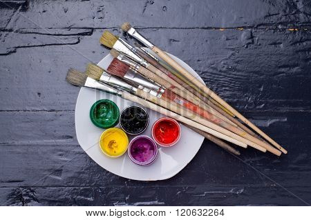 Colours In The Jars, Brushes And A Palette