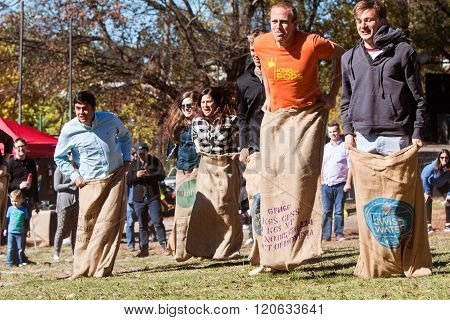 Young Adults Compete In Sack Race At Atlanta Festival