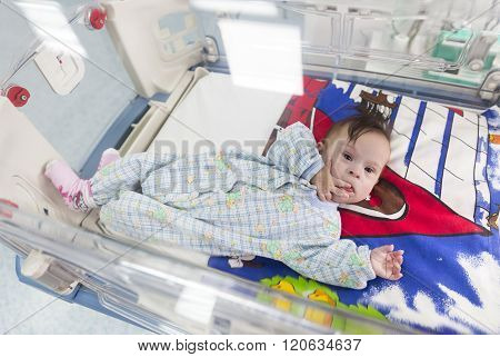 Baby Through An Incubator From Above