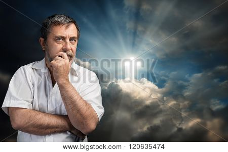 Elderly Man Thinking About Faith And God