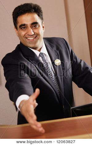 Businessman reaching out to shake the camera's hand