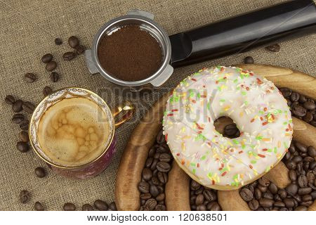 Fresh coffee and a donut. Sweet treats to hot coffee. Traditional dessert