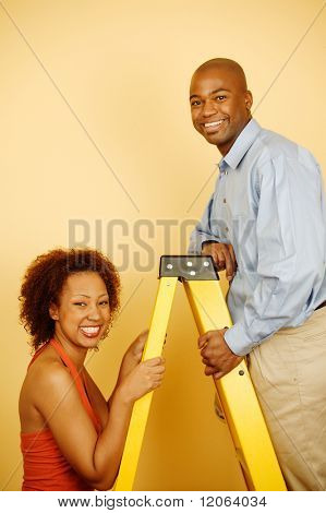 Portrait of couple with ladder