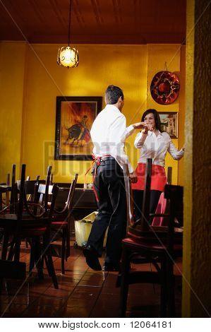 Wait staff dancing in empty restaurant